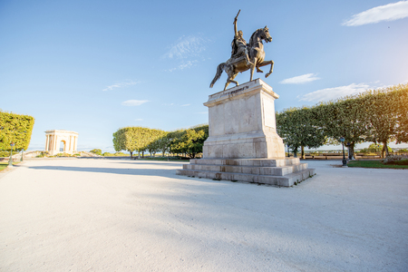 View on the beautiful Peyrou promenade with Louis statue in Montpellier city during the morning light in southern France Stock fotó