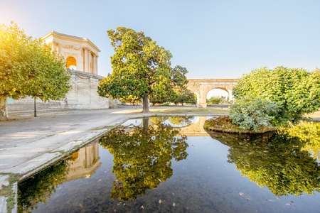 View on the saint Clement aqueduct in Peyrou garden with water reflection during the morning light in Montpellier city in southern France