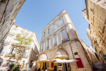 Street view at the old town with cafe terrace in Montpellier city in Occitanie region of France