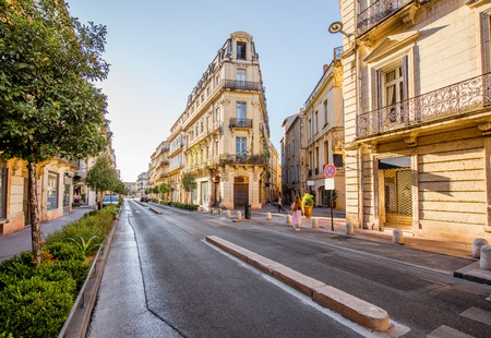 Street view with beautiful old luxurois buildings on the Foch boulevard during the morning light in Montpellier city in Occitanie region of France Stock Photo