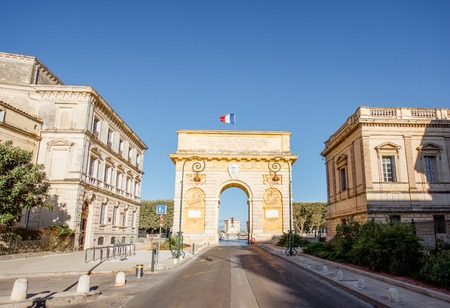 Street view with famous Triumphal Arch on the Foch boulevard during the morning light in Montpellier city in Occitanie region of France 版權商用圖片