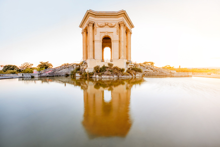 View on the water tower in Peyrou garden with beautiful water reflection during the evening light in Montpellier city in southern France Stock Photo