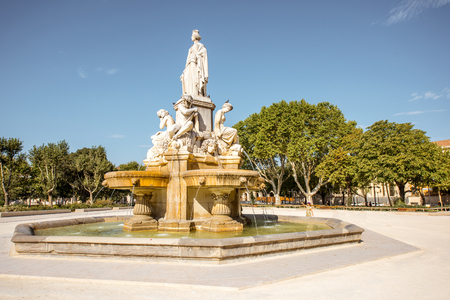 View on the Charles Gaulle fountain in Nimes city during the sunny morning in the Occitanie region of southern France