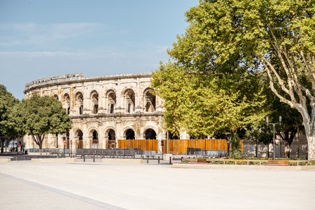 Morning view on the ancient Roman amphitheatre in Nimes city in the Occitanie region of southern France