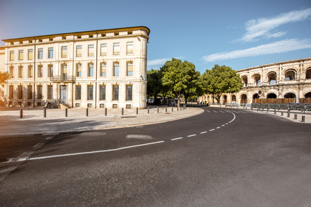 Morning street view with roman amphitheater building in Nimes city on southern france Reklamní fotografie
