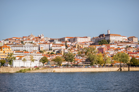 Cityscape view on the old town of Coimbra city with Mondego river during the sunny day in the central Portugal Stock Photo