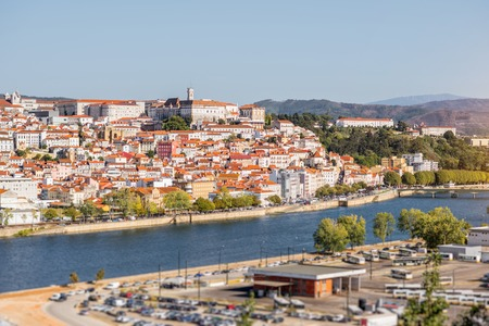 Cityscape view on the old town of Coimbra city with Mondego river during the sunny day in the central Portugal Stock fotó