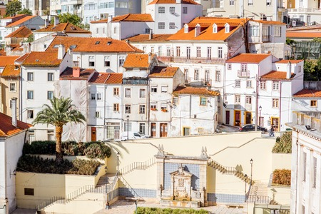 View on the beautiful white buildings on the hill in Coimbra city in the central Portugal