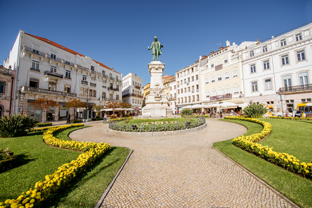 View on the beautiful square with Joaquim Augusto statue in Coimbra city in the central Portugal