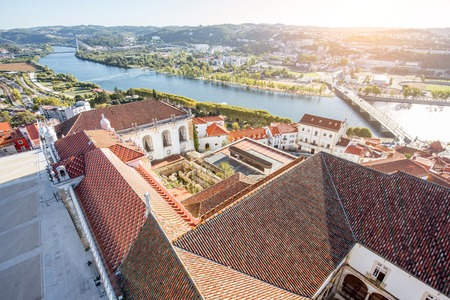 Aerial cityscape view on the old town of Coimbra during the sunset in the central Portugal