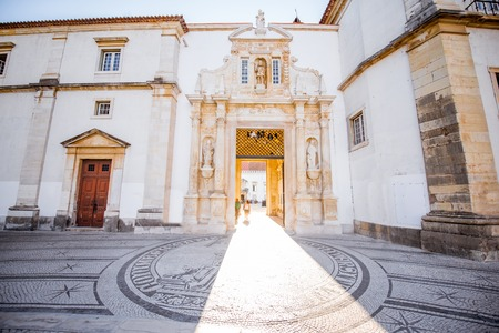 View on the main entrance to the courtyard of the old university building in Coimbra city in the central Portugal Stock Photo