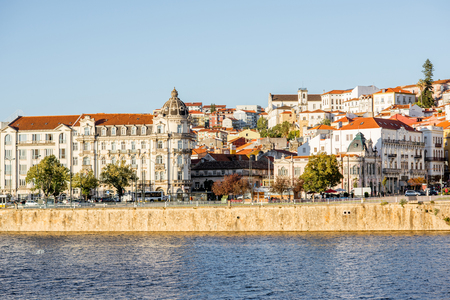 Cityscape view on the old town of Coimbra city with Mondego river during the sunset in the central Portugal Stock fotó
