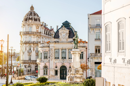 View on the beautiful square with Joaquim Augusto statue in Coimbra city during the sunset in the central Portugal