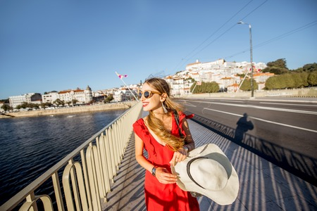 Woman walking on the bridge in Coimbra city during the sunset in the central Portugal Stock fotó