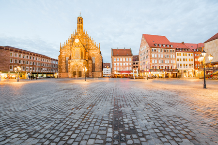 Night view on the illuminated market square with old cathedral in Nurnberg city, Germany Stock Photo