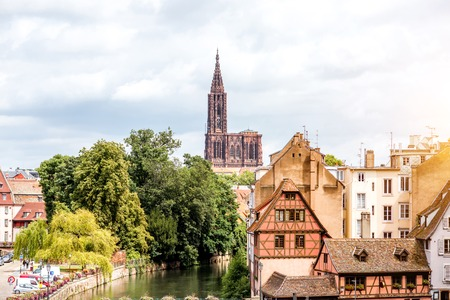 Cityscape view on the old town with beautiful buildings and cathedral in Strasbourg city in France