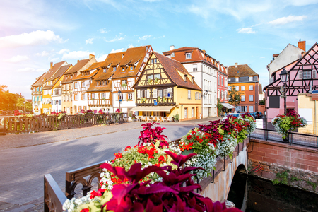 Landscape view on the beautiful colorful buildings on the water channel in the famous tourist town Colmar in Alsace region, France