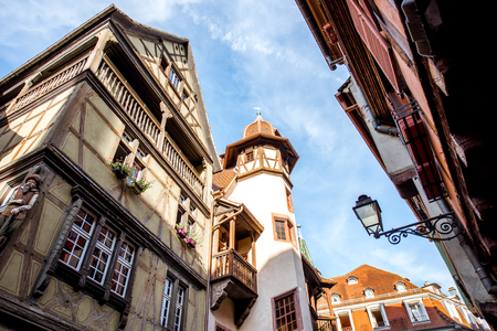 Street view on the beautiful old buildings in the famous tourist town Colmar in Alsace region, France