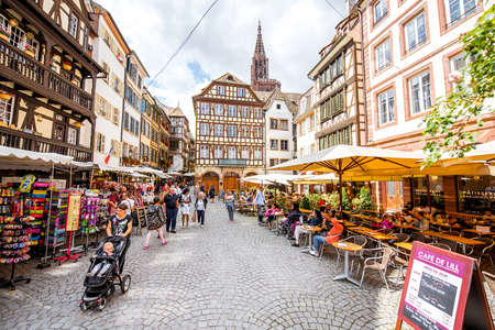 STRASBOURG, FRANCE - July 26, 2017: View on the beautiful square with people sitting at the cafes and restaurants in Strasbourg old town, France Editöryel