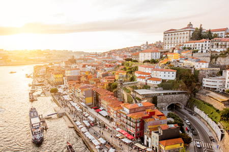 Top view on the Douro river with Ribeira promenade in the old town of Porto city during the sunset in Portugal