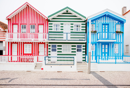 View on the beautiful colorful house facades on the Costa Nova beach in Portugal 스톡 콘텐츠