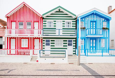 View on the beautiful colorful house facades on the Costa Nova beach in Portugal Archivio Fotografico