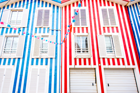 Facade view on the beautiful colorful striped house with windows for background