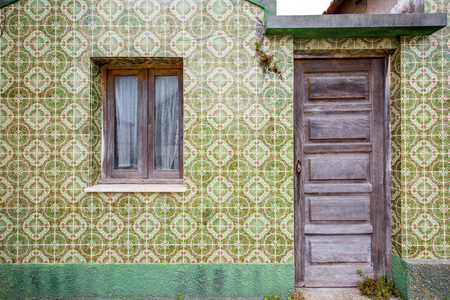 Facade view on the beautiful house wall with beautiful portuguese tiles for background
