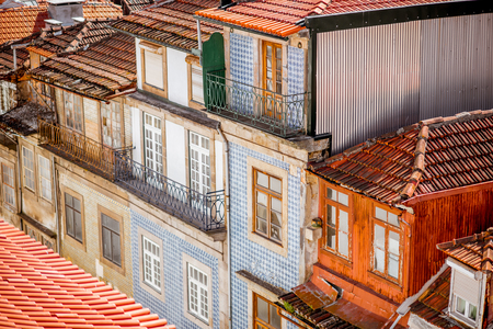 Top view on the beautiful old building facades with famous portuguese tiles on the street in the old town of Porto city, Portugal