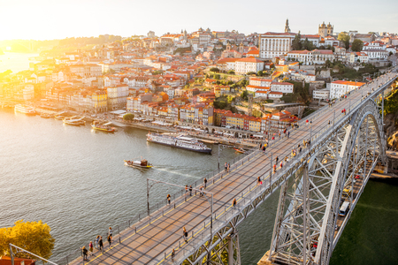Landscape aerial view on the Luis bridge on the Douro river in Porto city during the sunset in Portugal Stock Photo