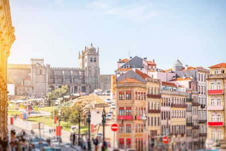 Cityscape view with beautiful old buildings and Se cathedral in Porto city. Image with tilt-shift blurred technic