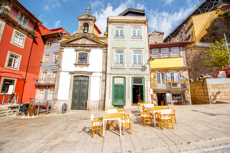 View on the Ribeira promenade with beautiful buildings and Lada chappel in Porto city, Portugal