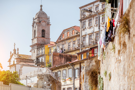 Street view on the beautiful old buildings and church tower in Porto city, Portugal