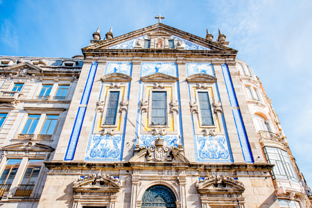 View on the facade with beautiful blue tiles of Congregados church in Porto city, Portugal