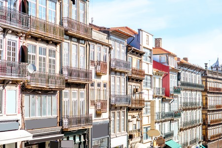 View on the beautiful old building facades with famous portuguese tiles on the street in the old town of Porto city, Portugal Imagens