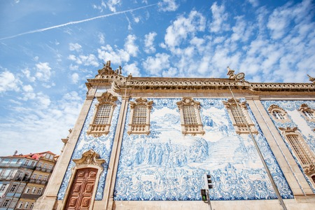 Facade view on the church wall with famous poruguese blue tiles Azulejo in Porto city in Portugal Banco de Imagens - 89949689