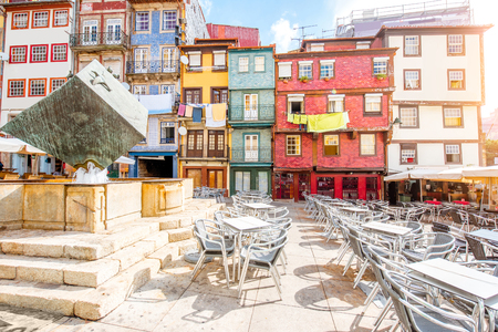 Street view on the beautiful old buildings with portuguese tiles on the Ribeira square in Porto city, Portugal