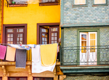 Cothes drying on the windows of the old buildings in Porto city, Portugal Imagens