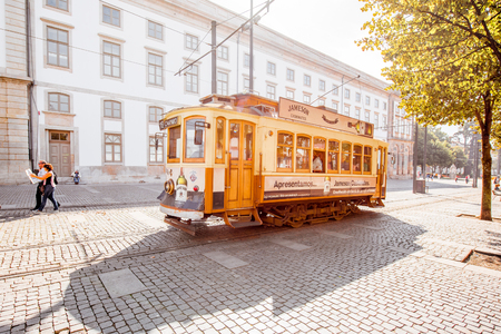 PORTO, PORTUGAL - September 24, 2017: Street view with retro tourist tram in Porto city