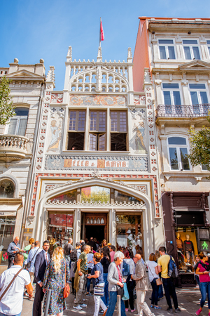 PORTO, PORTUGAL - September 24, 2017: View on the Lello Bookstore facade with tourists waiting for the entrance. It is one of the oldest bookstores in Portugal