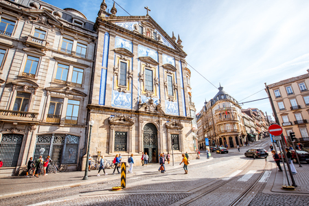 PORTO, PORTUGAL - September 24, 2017: Street view on the facade with beautiful blue tiles of Congregados church in Porto city, Portugal 報道画像