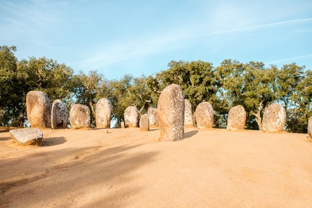 Sunrise view on the menhirs stones in megalithic monument of Cromelech dos Almendres in Portugal