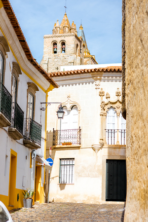 Street view with old cathedral tower in Evora city, Portugal Stock Photo