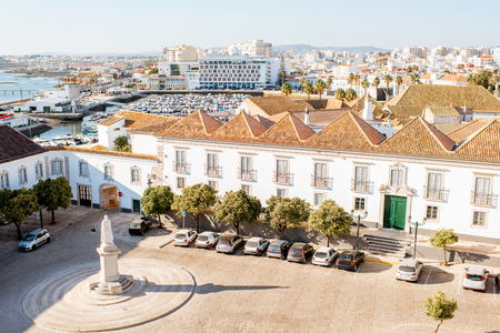 Top cityscape view on the old town with beautiful rooftops in Faro on the south of Portugal