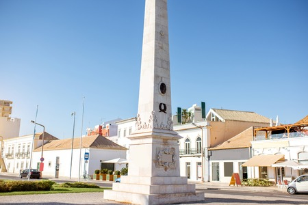 Street view with Column monument in Faro city on the south of Portugal
