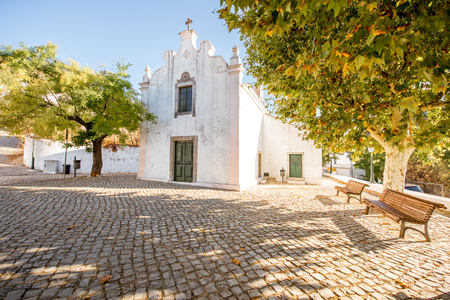 Typical village with white houses during the sunrise on the south of Portugal Фото со стока