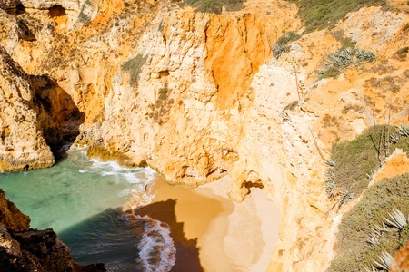 Top view on the beautiful sandy beach on the Ponta da Piedade near the Lagos city in Portugal