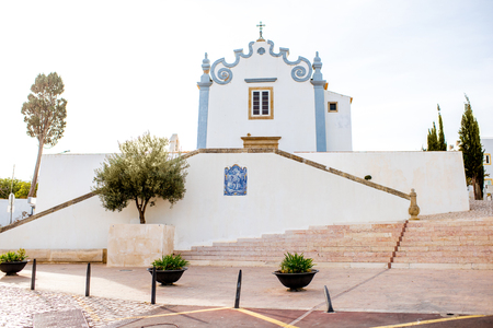 Cityscape view on the old town with saint Anna church in Albufeira city on the south of Portugal 写真素材