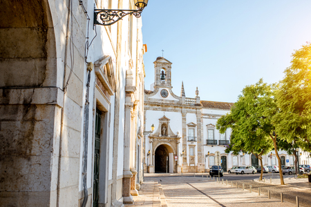 Street view with Cidade arch facade in the old town of Faro on the south of Portugal