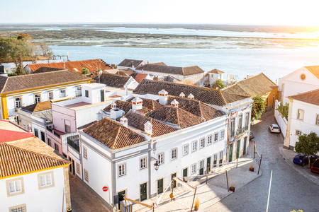 Top cityscape view on the old town with beautiful rooftops in Faro on the south of Portugal Foto de archivo - 90469532